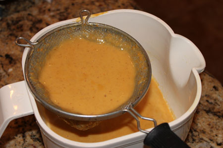 straining pumpkin pie fillings
