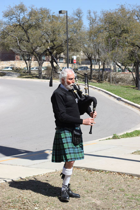 man in kilt with bagpipes