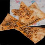 Baked Tortilla Chips Topped With Spices