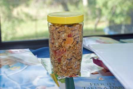 peanut butter jar full of granola