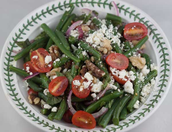 ... green bean salad made with green beans feta mint and walnuts