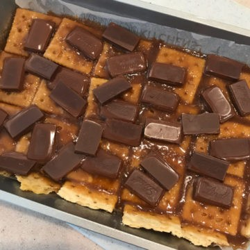 Saltine Cracker Candy as a half batch.  This picture shows the chocolate melting over the toffee mixture.