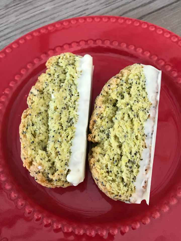 Sourdough Lemon Poppy Seed Biscotti on a red plate.
