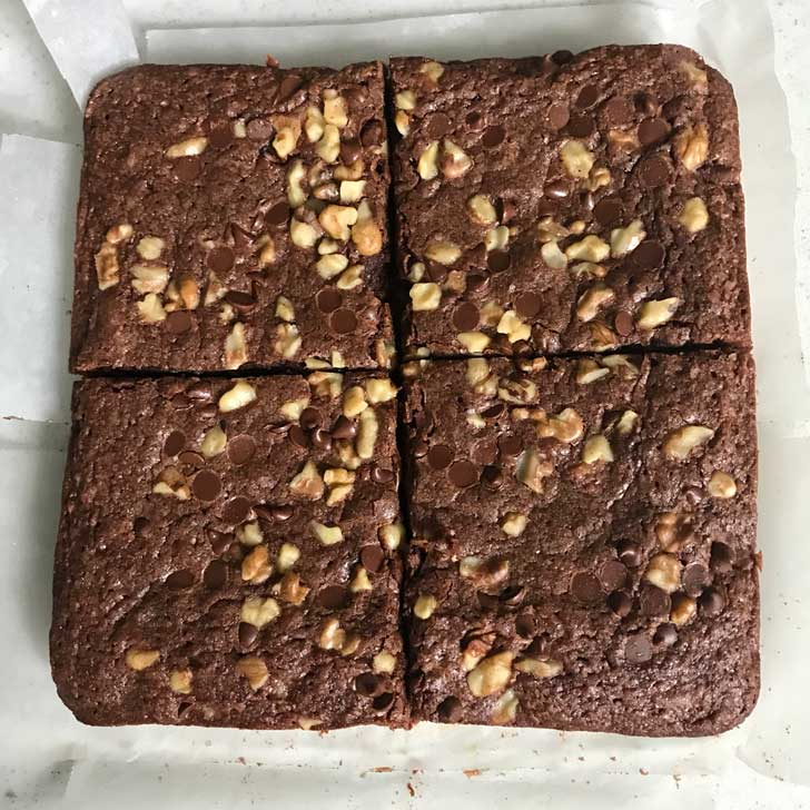 Cake Flour Brownies on a sheet of parchment paper.