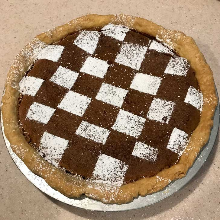 Chocolate Chess Pie with confectioners' sugar grid.