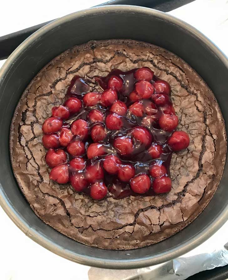 Cherry Topped Brownie Cheesecake with Lucky Leaf brand cherry pie filling.